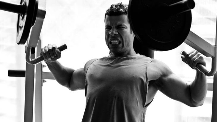 Man Performing Hammer Strength Chest Press