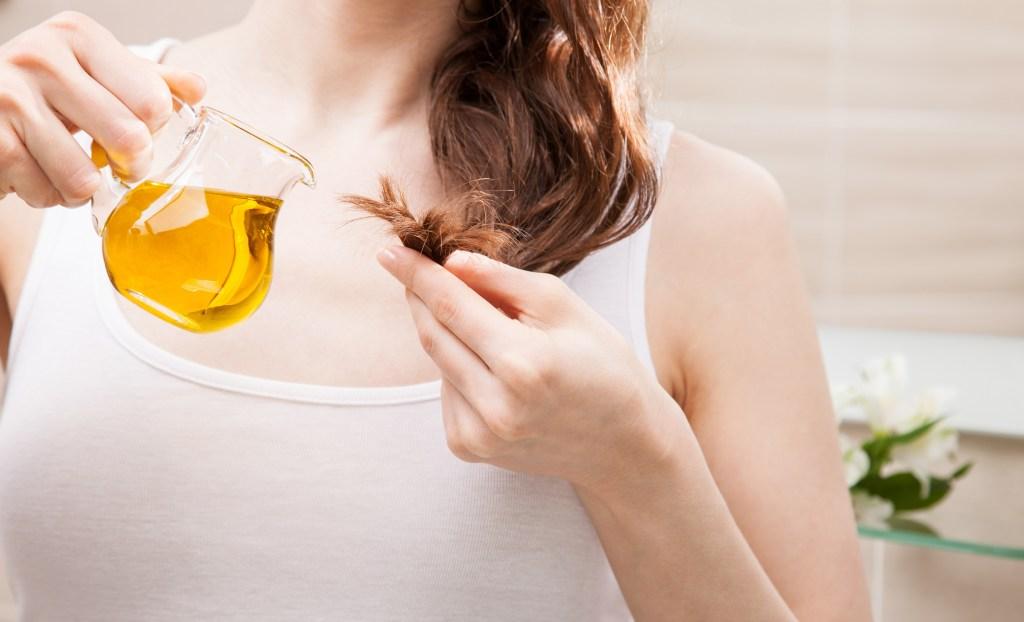 Woman Applying Fenugreek Oil on Her Hair