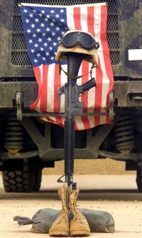 An_M16-A2_service_rifle,_a_pair_of_boots_and_a_helmet_stand_in_tribute_to_a_fallen_Marine_Corps_Sergeant-