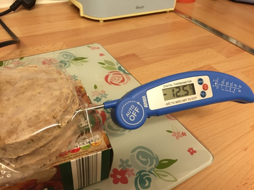 Meat thermometer in frozen burgers