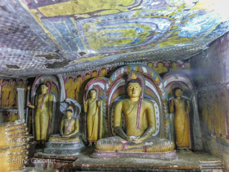 Buddha Statues in Caves at Golden Temple Dambulla ooaworld Rolling Coconut Photo Ooaworld