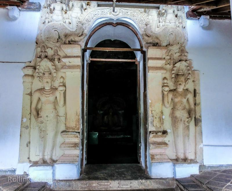 Carvings Door Golden Temple Cave Dambulla Sri Lanka ooaworld Rolling Coconut Photo Ooaworld