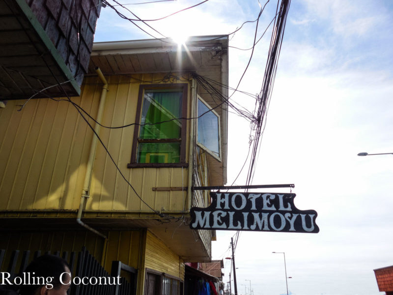 Chile Chiloe Quellon Hostel Quellon Outside Sign Rolling Coconut OOAworld Photo Ooaworld