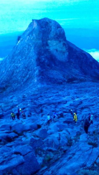 Walking Peak Mount Kinabalu Borneo photo ooaworld Rolling Coconut