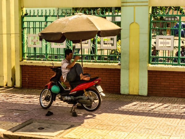 motocyclist rest saigon vietnam photo ooaworld Rolling Coconut