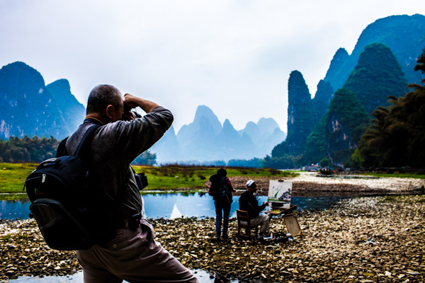 A photographer captures a painter in action, Yangshuo