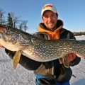 tip-up tricks - man holding a large pike