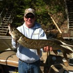 David Donaldson with a Northern Pike caught on Desert Lake with an orange and gold spoon