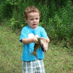 Troy Nevin,3, and his first fish (taken in the summer of 2013).