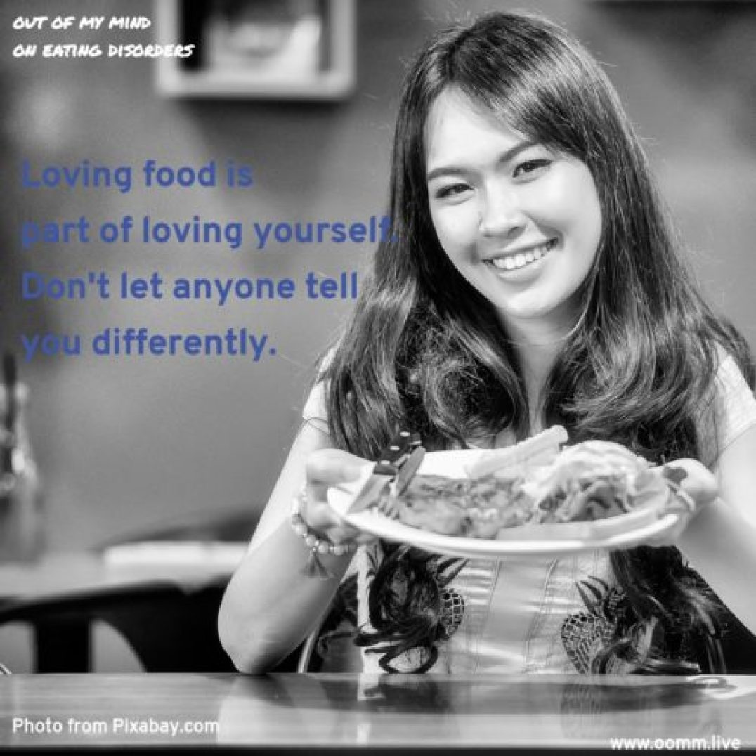 A healthy love of food prevents eating disorders. Asian woman holding a plate with hamburger and fries, smiling