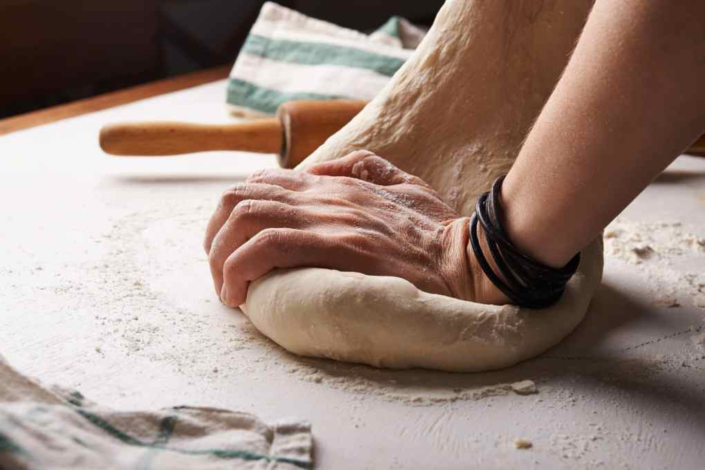 How does yeast make bread rise? Why do we need to knead most breads?