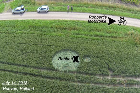 14 de julio - Robbert aparentemente está recogido por grandes bolas de luz y se deposita en el interior de un nuevo círculo de la cosecha de la marca.  Foto: Ronald Sikking