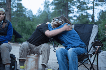 Mother and son embrace as they begin to repair family dynamics during Open Sky Family Quest