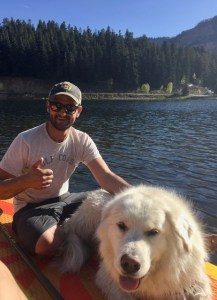 Chris Blankenship enjoys his time off with his dog on a lake.