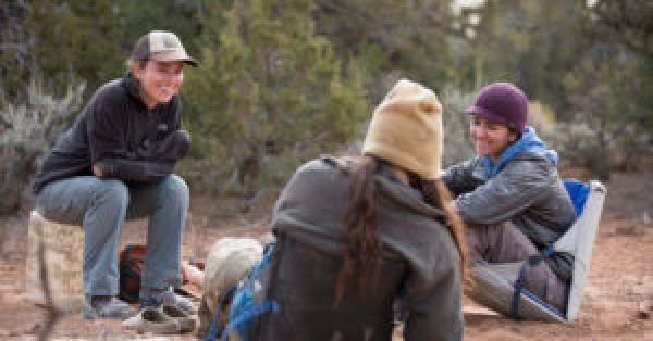 Young adult therapist Mariah Loftin in session with student and field guide