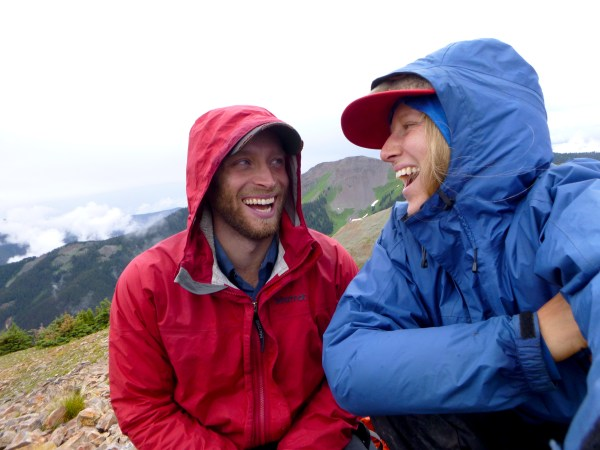 Open Sky field guides laugh in the rain.