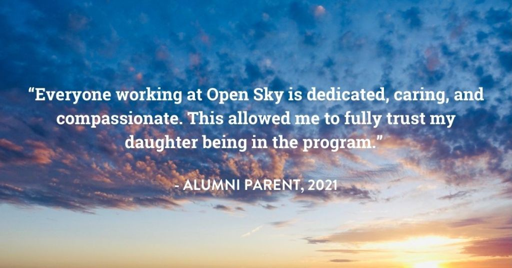 """A striking sunrise with white text that reads, """"Everyone working at Open Sky is dedicated, caring, and compassionate. This allowed me to fully trust my daughter being in the program."""" - Alumni Parent, 2021"""