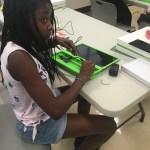 OWL Scholar assembling her computer.