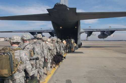 army airborne students walking into a c 130