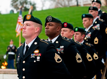 army green berets standing at attention
