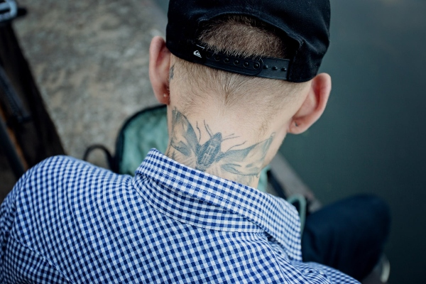 navy neck tattoo