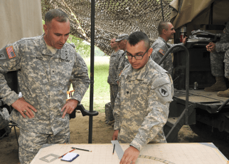 13D MOS Specialist shows a fire direction chart
