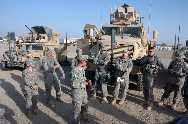 National Guard conduct a briefing at Camp Liberty, Iraq, before a mission