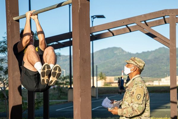 Soldier performs leg tuck forThe Army Combat Fitness Test (ACFT)