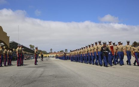 Marines march across the parade deck during a graduation ceremony at Marine Corps Recruit Depot