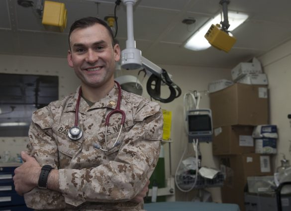 marine corps doctor poses for photograph