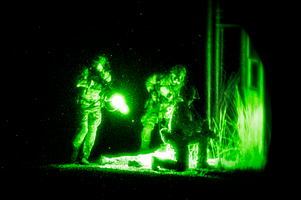Army Special Forces members search a simulated casualty during a training exercise