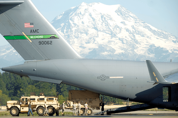 loading Army personnel at Joint Base Lewis-McChord