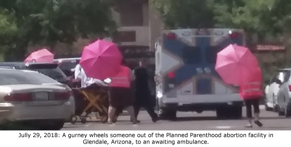 Planned Parenthood's Pink Umbrellas Fail to Hide Medical Emergency