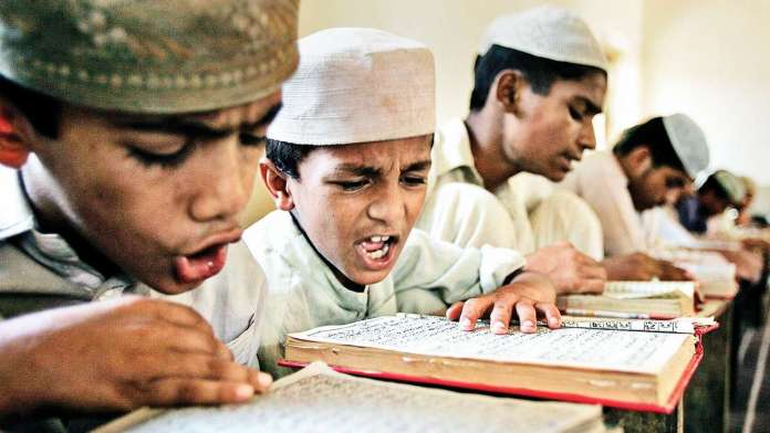 Headmaster Khurshid Ahmed converts government school to Islamia School because most students are Muslims