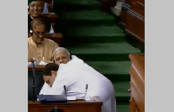 In an iconic moment Rahul Gandhi hugs and winks at PM Modi in Parliament, Twitter erupts in reactions