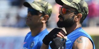 Dhoni and Kohli wearing military caps