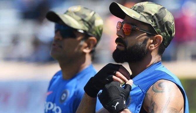 Dhoni and Kohli wearing military caps
