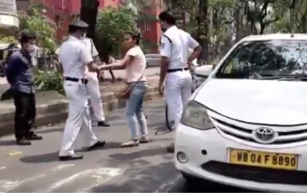 viral video shows a girl in Kolkata abusing cops as her car is stopped during lockdown