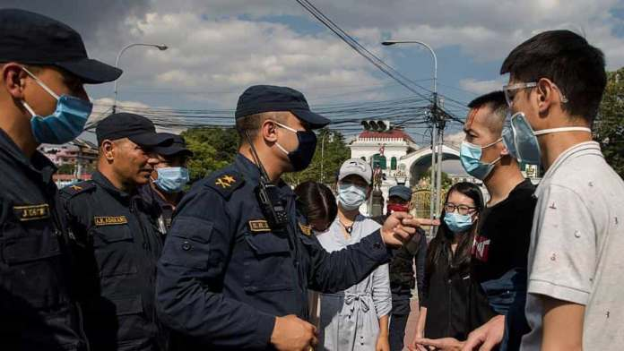 Chinese citizens stranded in Nepal ape their Communist government in China, resort to bullying and stone-pelting to get their demands fulfilled