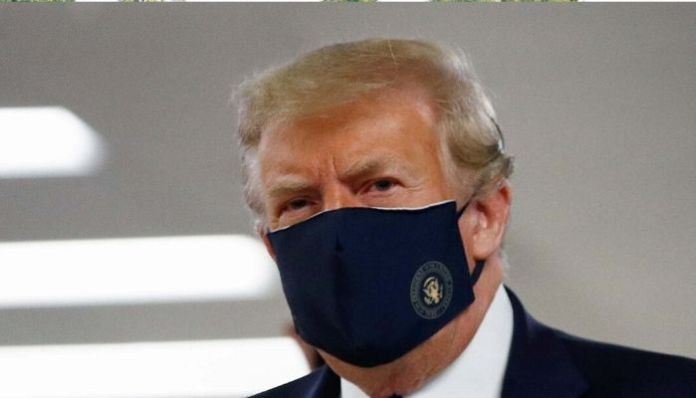 Donald Trump makes first public appearance with a face covering
