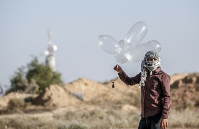 Hamas and Israel reach an unusual pact to end hostilities in Gaza border