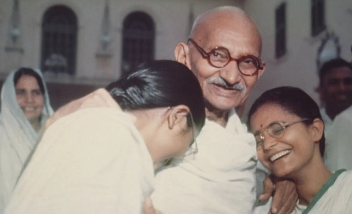 Mahatma Gandhi with Abha and Manu