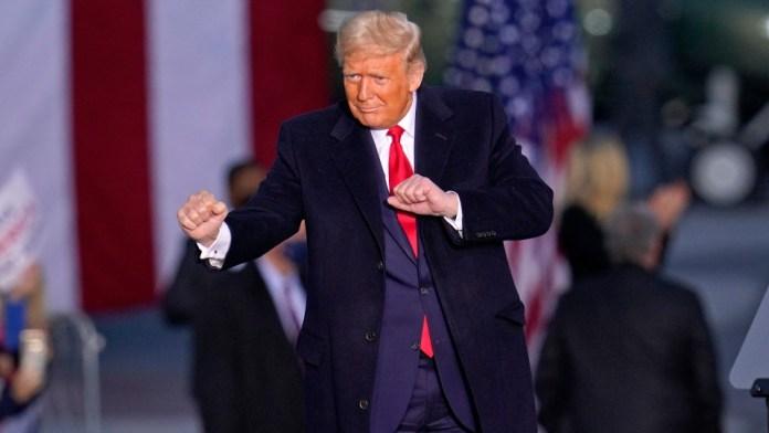 Donald Trump dances at a rally