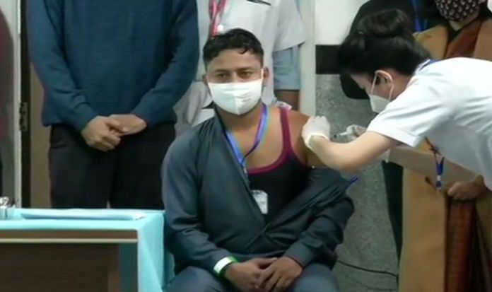 Manish Kumar becomes the first to be injected with COVID-19 vaccine under India's vaccination programme
