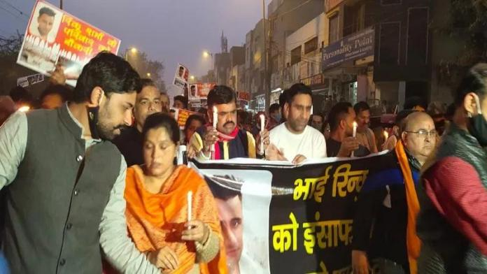 Residents of Mangolpuri area carry out a march to demand justice for Rinku Sharma