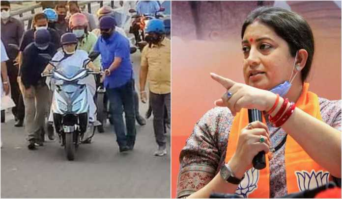 Smriti Irani rides scooter in Bengal, replies to Mamata's comments