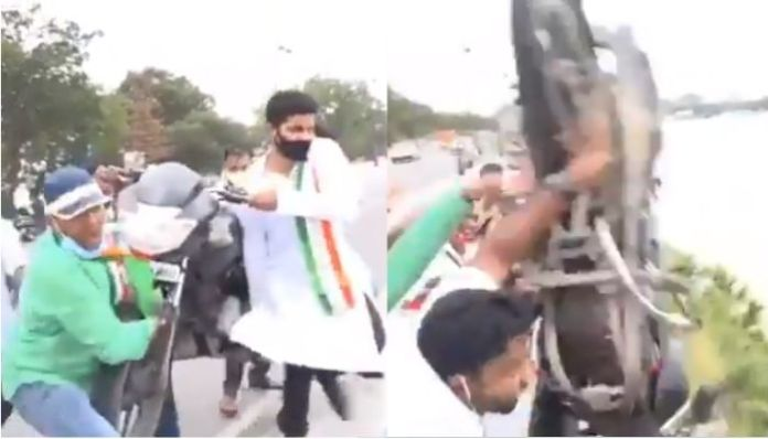 Youth Congress workers throw bike into lake to protest against Modi government: Watch and know why