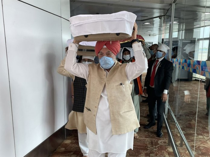 3 Sikhs who had carried the Guru Granth Sahib from Afghanistan tested positive for Covid