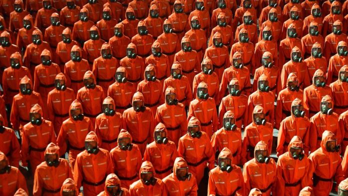 Even as North Korea claims victory over COVID, military parade features hazmat suits, gas masks, as economic crisis due to pandemic worsens