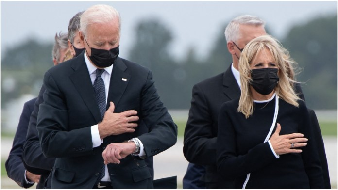 Biden glancing at his watch during ceremony for martyrs invites criticism